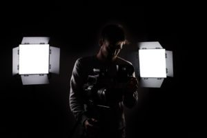 Fionn Crow with camera and lights