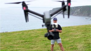 River flying drone on Cornish cliffs